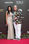 John Daly and his friend walk the Red Carpet event at the World Celebrity Pro-Am 2016 Mission Hills China Golf Tournament on 20 October 2016, in Haikou, China. Photo by Weixiang Lim / Power Sport Images