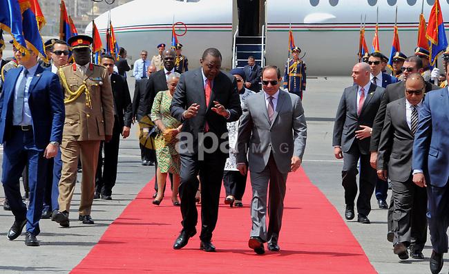 Egyptian President Abdel Fattah al-Sisi welcomes Kenyan President Uhuru Kenyatta upon his arrival at Cairo's international airport in Cairo, Egypt, on May 10, 2017. Photo by Egyptian President Office