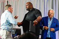 August 8, 2017: Vince Wilfork (right) shakes hands with New England Patriots head coach Bill Belichick after signing a one day contract at Wilfork's retirement announcement held at the Optum Field Lounge, in Gillette Stadium, in Foxborough, Mass.