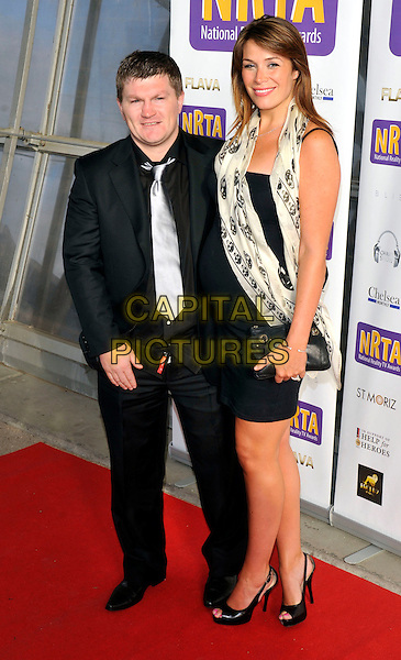 Ricky Hatton & Jennifer Dooley.The National Reality TV Awards 2011 at Proud 2, The O2 Arena, London, England..July 6th 2011.full length black suit white scarf silver grey gray tie couple tall short.CAP/ROS.©Steve Ross/Capital Pictures