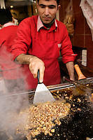 Kokorec (grilled sheep's intestines) being cooked in Kadikoy, Istanbul, Turkey