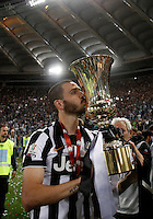 Calcio, finale Tim Cup: Juventus vs Lazio. Roma, stadio Olimpico, 20 maggio 2015.<br /> Juventus' Leonardo Bonucci kisses the trophy at the end of the Italian Cup final football match between Juventus and Lazio at Rome's Olympic stadium, 20 May 2015. Juventus won 2-1 after extra time.<br /> UPDATE IMAGES PRESS/Isabella Bonotto