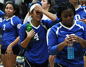A dejected Grace Sanders (4), Southfield Christian, walks off the floor after falling to Fowler 3-0 in Class D quarterfinal volleyball action at Goodrich High School Tuesday, Nov. 14, 2017. Hayley Ellington (3) and Keirsten Mitchell (13), are also pictured. (For The Oakland Press / LARRY McKEE)
