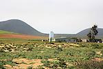 Rural Mexican homestead alongside silo