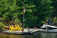 Muskoka chairds on dock<br />
