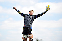 Dom Day rises high to win lineout ball. Bath Rugby pre-season training session on July 18, 2014 at Farleigh House in Bath, England. Photo by: Patrick Khachfe/Onside Images