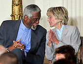 """Bill Russell, left, and Jean Kennedy Smith, right, share a thought during the ceremony where United States President Barack Obama and first lady Michelle Obama honor them and the other recipients of the 2010 Medal of Freedom, """"the Nation's highest civilian honor presented to individuals who have made especially meritorious contributions to the security or national interests of the United States, to world peace, or to cultural or other significant public or private endeavors"""", in a ceremony in the East Room of the White House in Washington, D.C. on Tuesday, February 15, 2011..Credit: Ron Sachs / CNP"""