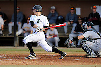 Right fielder Cody Brittain (18) of the University of South Carolina Upstate Spartans hits in a game against the Winthrop University Eagles on Wednesday, March 4, 2015, at Cleveland S. Harley Park in Spartanburg, South Carolina. Upstate won, 12-3. (Tom Priddy/Four Seam Images)