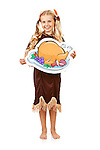 Series with children dressed in costume to celebrate the American Thanksgiving holiday.  Boy as pigrim, girl as Native American.  Isolated on a white background.