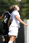 11 October 2009: Duke's Maddy Haller (right) and Florida State's Tiffany McCarty (14) challenge for a header. The Duke University Blue Devils played the Florida State University Seminoles to a 0-0 tie after overtime at Koskinen Stadium in Durham, North Carolina in an NCAA Division I Women's college soccer game.