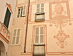 Decorated facade of buildings in downtown Como, Italy