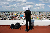"Photographer Sze Tsung Leong shooting part of his ""Horizons"" series on an 8x10 camera. Panoramic views of Ciudad Nezahualcoyotl, part of Mexico City's urban sprawl."