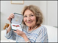 BNPS.co.uk (01202 558833)Pic:  PhilYeomans/BNPS<br /> <br /> Gabriella with her Star of Italy.<br /> <br /> Brighton nonagenarian Gabriella Ezra(91) has finally been recognised for her wartime heroics...<br /> <br /> The extraordinary story of how a teenage girl saved an entire village from being executed by the Nazis has come to light after she finally received a gallantry award nearly 74 years later.<br /> <br /> Fearless Gabriella Ezra, 91, who lives in Brighton, Sussex, intervened to stop her father Luigi and 37 other inhabitants of a rural village in her native Italy from being massacred by a firing squad during the chaotic last days of WW2.<br /> <br /> She has now been awarded an Italian Star of Italy medal after her son Mark wrote to the Italian embassy to make them aware of her remarkable actions on the morning April 28, 1945.<br /> <br /> Gabriella, who was 17 years old at the time, chased after a German officer and pleaded with him to show mercy to the villagers of Capella di Scorze, near Venice, who had been rounded up and locked in a cowshed.<br /> <br /> The Germans were after retribution following an attack on their men by Italian partisans which had left several of them wounded.