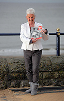 Pictured: Pat Stewart at Barry, south Wales, holding a copy of the Picture Post. <br /> Re: 77 year old Pat Stewart (nee Wilson) who now lives near Llantwit Major in the Vale of Glamorgan, south Wales claims she is one of the two young ladies in an iconic image taken by photographer Bert Hardy at Blackpool Promenade in July 1951, alongside fellow Tiller girl Wendy Clarke. Stewart is alleging that another woman, Norma Edmondson who has been claiming that it is her in the picture, is a fraud.<br /> PLEASE NOTE THAT THE IMAGE SHOWN OF PAT STEWART AND WENDY CLARK ON MANY ITEMS (CONTACT SHEETS, MUGS, COVERS, BOOKS, MAGAZINES ETC) WAS TAKEN BY PHOTOGRAPHER BERT HARDY AND IS CURRENTLY BEING SYNDICATED BY GETTY IMAGES WHO OWN ITS COPYRIGHT. IT IS SUPPLIED ONLY TO SUPPORT PAT STEWART'S CLAIMS