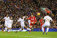 Kyle Naughton blocks a shot on goal by Adam Lallana during the Barclays Premier League Match between Liverpool and Swansea City played at Anfield, Liverpool on 29th November 2015
