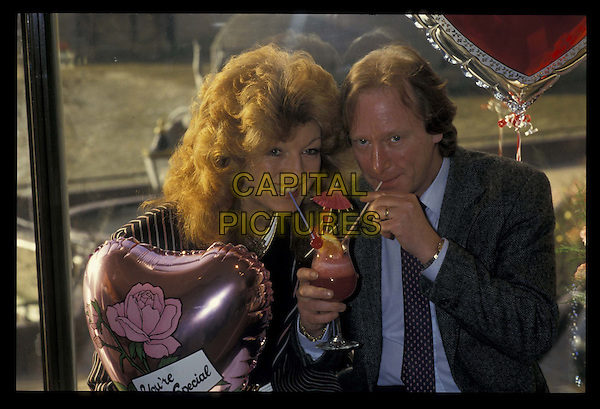 DENNIS WATERMAN & RULA LENSKA.Ref:026.cocktail, half length, half-length.*RAW SCAN- photo will be adjusted for publication*.www.capitalpictures.com.sales@capitalpictures.com.©Capital Pictures