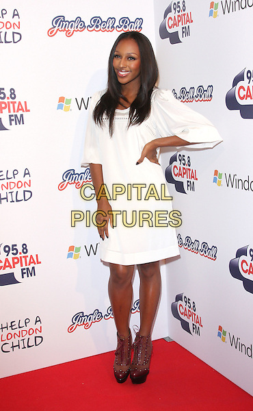 ALEXANDRA BURKE.At the 95.8 Capital FM Jingle Bell Ball in association with Windows 7,. O2 Arena, London , England, UK,.December 4th 2010..full length white dress hand on hip brown platform ankle boots lace-up .CAP/ROS.©Steve Ross/Capital Pictures