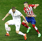 Atletico de Madrid's Jose Maria Gimenez (r) and Real Madrid's Karim Benzema during La Liga match. October 4,2015. (ALTERPHOTOS/Acero)
