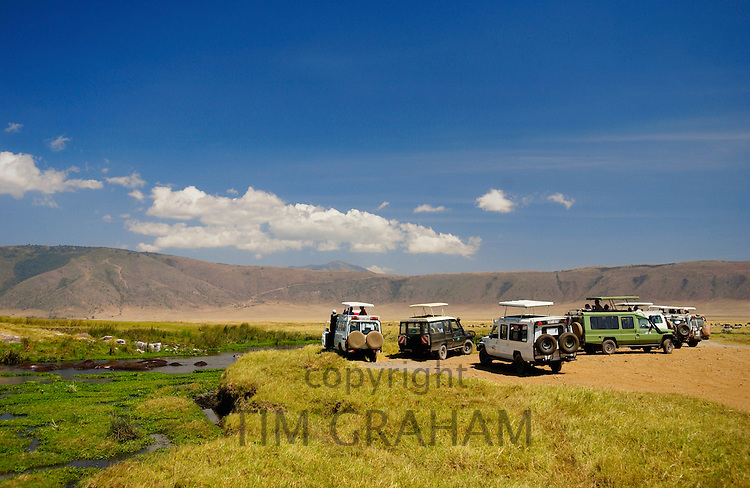 Tourists in the Ngorongoro Crater,Tanzania RESERVED USE - NOT FOR DOWNLOAD -  FOR USE CONTACT TIM GRAHAM