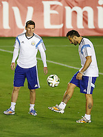 Lionel Messi of Argentina and Ezequiel Lavezzi during the training session