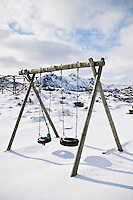 Empty tire swing in winter, Lofoten islands, Norway