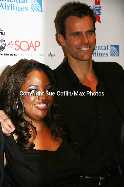 The View's Sherri Shepherd poses with Cameron Mathison - AMC at the 6th Annual ABC/SoapNet salutes Broadway Cares/Equity Fights Aids on March 21, 2010 at the New York Marriott Marquis, New York City, New York. (Photo by Sue Coflin/Max Photos)