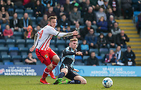 Jason McCarthy of Wycombe Wanderers tackles Dean Parrett of Stevenage during the Sky Bet League 2 match between Wycombe Wanderers and Stevenage at Adams Park, High Wycombe, England on 12 March 2016. Photo by Andy Rowland/PRiME Media Images.