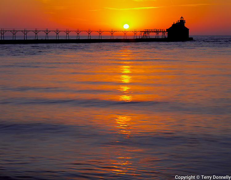 Door County, WI         <br /> Sturgeon Bay Canal North Pierhead Lighthouse silhouetted by Lake Michigan sunrise