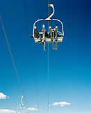 USA, Utah, two skiers on a chair lift at Deer Valley Ski Resort