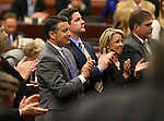 Nevada Gov. Brian Sandoval, left, applauds following Republican Rep. Joe Heck's speech to a joint session at the Legislative Building in Carson City, Nev., on Monday, March 30, 2015. <br /> Photo by Cathleen Allison