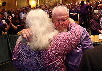 Parents of Heather Heyer Susan Bro, left, and Mark Heyer, right, embrace during a memorial for their daughter Wed., August 16, 2017, at the Paramount Theater in Charlottesville, Va. Heyer was killed the previous weekend when a vehicle drove into a crowd of counter-protestors after the Unite The Right rally. Photo/Andrew Shurtleff