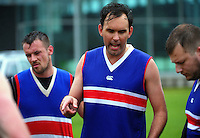 The Bulldogs discuss tactics at halftime the Wellington Australian Rules Football club final match between the Bulldogs and North City Demons at Hutt Park, Wellington, New Zealand on Saturday, 22 November 2014. Photo: Dave Lintott / lintottphoto.co.nz
