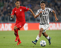 Calcio, Champions League: Gruppo D - Juventus vs Siviglia. Torino, Juventus Stadium, 30 settembre 2015. <br /> Juventus&rsquo; Paulo Dybala, right, is chased by Sevilla's Timothee Kolodziejczak during the Group D Champions League football match between Juventus and Sevilla at Turin's Juventus Stadium, 30 September 2015.<br /> UPDATE IMAGES PRESS/Isabella Bonotto