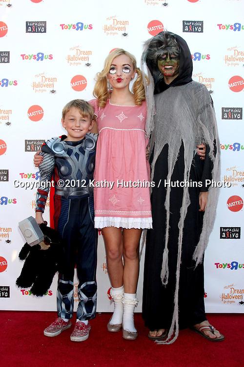 "LOS ANGELES - OCT 27:  Phoenix List, Peyton List, Spencer List arrives at ""Keep A Child Alive Presents 2012 Dream Halloween Los Angeles"" at Barker Hanger on October 27, 2012 in Santa Monica, CA"