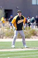 Josh Willingham #16 of the Oakland Athletics participates in spring training workouts at the Athletics complex on February 23, 2011  in Phoenix, Arizona..Photo by:  Bill Mitchell/Four Seam Images.