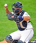 25 July 2010: Vermont Lake Monsters catcher Wilfri Pena warms up a pitcher in the bullpen during a game against the Tri-City ValleyCats at Centennial Field in Burlington, Vermont. The ValleyCats came from behind to defeat the Lake Monsters 10-8 in NY Penn League action. Mandatory Credit: Ed Wolfstein Photo
