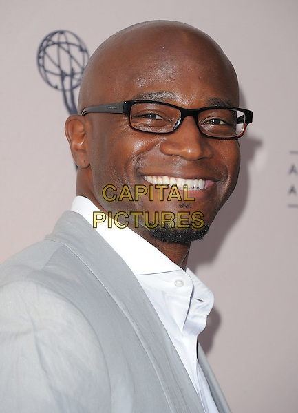Taye Diggs.Welcome To ShondaLand: An Evening with Shonda Rhimes & Friends held at The Leonard H. Goldenson Theatre  in North Hollywood, California, USA..April 2nd, 2012.headshot portrait white grey gray glasses goatee facial hair smiling .CAP/RKE/DVS.©DVS/RockinExposures/Capital Pictures.