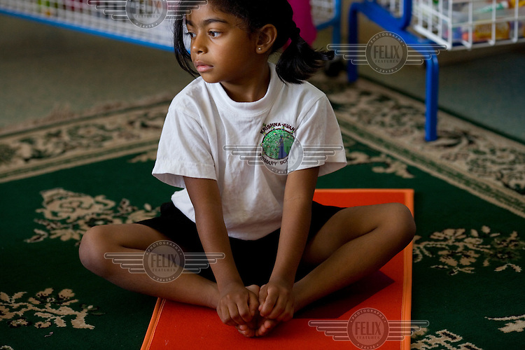 Pupils are taught yoga at the Krishna-Avanti primary school in Harrow, North London, the first state-funded Hindu faith school in Britain..