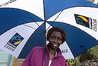 KENYA Thika near Nairobi, Simbi Roses is a fair trade rose flower farm which produces rose as cutting flowers for export to europe, worker Lucy Waithira Ngunga, 44 years old / KENIA Thika bei Nairobi, Simbi Roses ist eine fairtrade zertifizierte Blumenfarm die Rosen fuer den Export nach Europa anbauen, Pflueckerin Lucy Waithira Ngunga, 44 Jahre alt, vor ihrem Haus