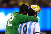 Ecuador goalkeeper Alexander Dominguez (22) hugs Argentina forward Gonzalo Higuain (9) after Higauin failed to draw a foul call. Argentina and Ecuador played to a 0-0 tie during an international friendly at MetLife Stadium in East Rutherford, NJ, on November 15, 2013.