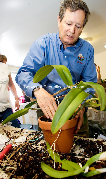 LITCHFIELD, CT- 22 APRIL 07- 042207JT09- <br /> Steve Frowine holds a hands-on orchid workshop at White Flower Farm in Litchfield on Saturday April 21.<br /> Josalee Thrift Republican-American