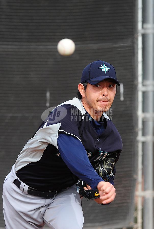 Feb. 15, 2012; Peoria, AZ, USA; Seattle Mariners pitcher Hisashi Iwakuma throws during a pitchers and catchers workout at the Peoria Sports Complex.  Mandatory Credit: Mark J. Rebilas-.