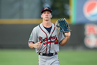 Danville Braves center fielder Drew Waters (12) jogs off the field between innings of the game against the Burlington Royals at Burlington Athletic Stadium on August 12, 2017 in Burlington, North Carolina.  The Braves defeated the Royals 5-3.  (Brian Westerholt/Four Seam Images)