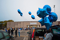 Helium-filled balloons festoon a van in the parking lot of an early voting center in Columbus, Ohio,  on the first day of early voting in the state..