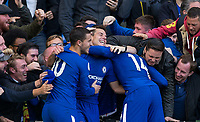 Cesar Azpilicueta (centre) of Chelsea celebrates his goal with teammates & supporters during the Premier League match between Chelsea and Watford at Stamford Bridge, London, England on 21 October 2017. Photo by Andy Rowland.