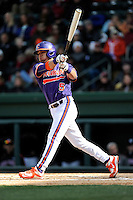 Second baseman Chase Pinder (5) of the Clemson Tigers bats in the Reedy River Rivalry game against the South Carolina Gamecocks on Saturday, February 28, 2015, at Fluor Field at the West End in Greenville, South Carolina. South Carolina won, 4-1. (Tom Priddy/Four Seam Images)