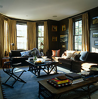 The family room is decorated in a brown colour palette and is bathed in sunlight