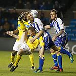 Kilmarnock's Jeroen Tesselaar gets a boot in the face from Steven Anderson as Ryan O'Leary looks on