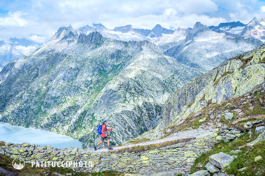 Hiking on the Grimsel Pass on a summer day, Switzerland