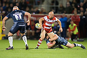 29th September 2017, AJ Bell Stadium, Salford, England; Aviva Premiership Rugby, Sale Sharks versus Gloucester; Gloucester Rugby's Willi Heinz pases the ball as he is tackled by Sale Sharks' Ross Harrison